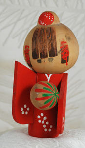 Kokeshi doll with temari ball
